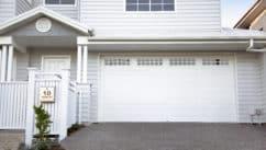 Centurion White Garage Door on a Large House