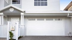 Centurion White Garage Door on a Large House